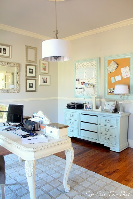 Pretty use of a chest, cork boards and fancy, yet simple desk.